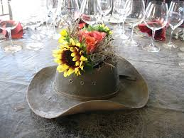 use a cowboy hat as a vase for your reception table centerpiece