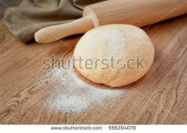 table cuisine en pin roller pin dough on wooden table stock photo 556204078