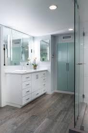 wood grain ceramic tile bathroom contemporary with bath tub
