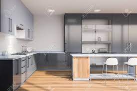white kitchen cupboards and grey walls interior of stylish kitchen with white walls wooden floor