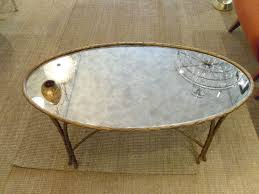 jansen gilt reeded oval coffee table with mirrored glass top at