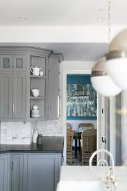 grey kitchen cabinets and black countertops gray kitchen cabinets with honed black countertops