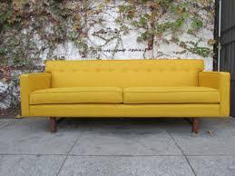 mid century vintage style sofa in mustard sunbeam vintage