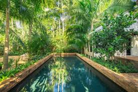 Landscaping Around A Pool by Landscape Your Pool For A Lush Look Diy