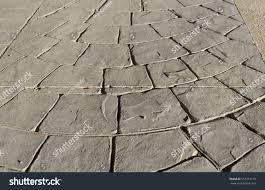 Wood Grain Stamped Concrete by Stamped Concrete Pavement Outdoor Expansion Joint Stock Photo