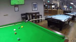incredible rube goldberg trick shot that spans multiple billiards