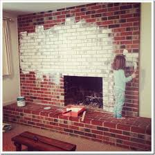 caught in grace painting a brick fireplace