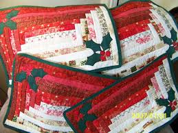 stretched log cabin placemats with holly applique love them