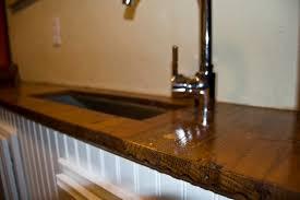 reclaimed hardwood floor as countertop mauledbydesign