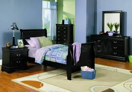 blue wall paint with black wooden bed and bedside table combined