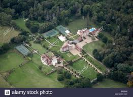 aerial view north west of country houses tennis courts swimming