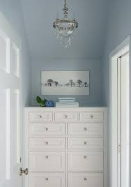 bedroom nook with white dresser and fragrance tray under window