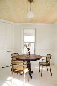 expert advice how to use wood paneling to add loftiness to a room lisa przystup catskills farmhouse dining room photo by april valencia