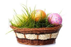 easter egg basket the easter eggs on fresh green grass in basket isolated on white