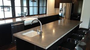 black island concrete countertop white undermount and tile in sink