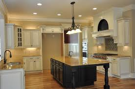 white kitchen with black island antique white kitchen cabinets with island kutskokitchen