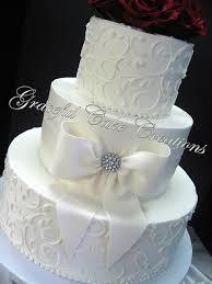elegant white butter cream wedding cake with fondant sash u2026 flickr