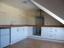 Kitchen Laminate Floors Kitchen Floor Brown Cabinet Yellow Hanging Pendant Lights Creame