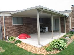 Aluminum Wood Patio by Patio Two Small Plants In Front Of House With Wooden Patio Roof