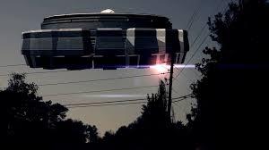cartoon space alien in ufo looping matte motion background