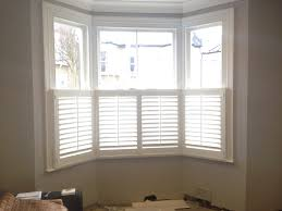 cafe style window shutters 76mm slats in silk white before
