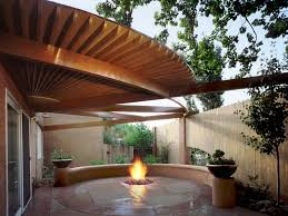 covered back patio with fireplace home design ideas