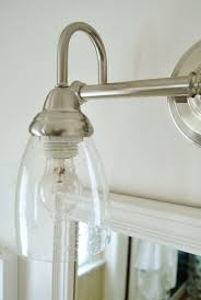 seeded glass light fixtures switching out the bathroom light twice young house love