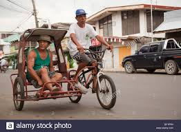 Man Riding In A Tricycle Taxi Passi City Iloilo Philippines Stock