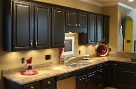 idyllic dark kitchen cabinets over white granite countertop also