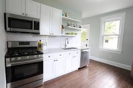 what tile goes with white cabinets white kitchen cabinets 4 ways revival designs
