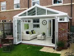 Bifold Patio Door by White Painted Sunroom Wall With White Polished Metal Frame Patio