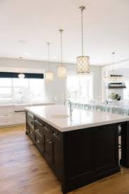 kitchen island with pendant lights i want an island so ridiculously that a family of four could