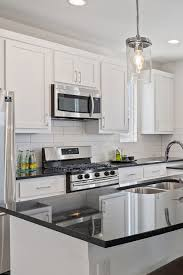 pictures of white kitchen cabinets with black stainless appliances 54 white cabinet black countertop inspiring look cabinets