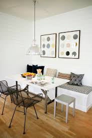 breakfast nook ideas white shiplap walls banquette with no back and throw pillows