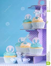 blue theme baby boy cupcakes on purple polka dot cupcake stand