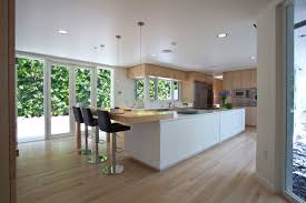 sleek modern black white kitchen with breakfast bar glass
