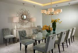 dining room with glass topped tabled and upholstered chairs
