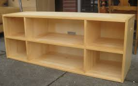 Wood Bookshelves Designs by Long Varnished Oak Wood Display Bookshelves Which Furnished With