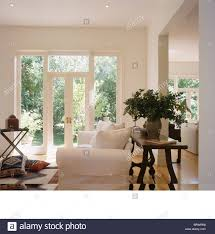Large Vase For Living Room Tall Vase Of Flowers On Antique Table Behind White Sofa In Modern