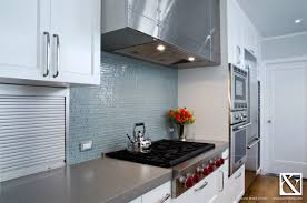 concrete countertops and glass tile backsplash in modern