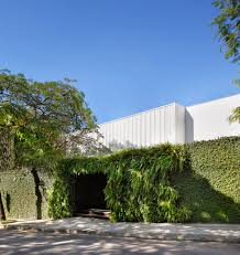 a house with a guarded front and an open interior courtyard