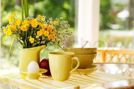 breakfast table breakfast table with wildflowers egg apple mug and bowls in