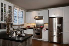 black cabinets with stainless steel backsplash contemporary