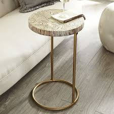 the ottoman vs the coffee table vs the pouf vs the c table