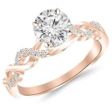 gold diamond engagement rings 0 5 carat twisting infinity gold and diamond split shank pave set