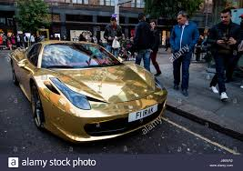 ferrari gold passers by admire a gold ferrari 458 spider owned by kickboxing