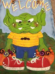 gremlin kid trick or treaters halloween welcome sign hand