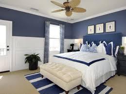 bedroom dark blue wall bed sofa benches line rug cream carpet
