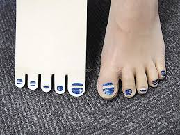 stockings with pre painted toenails are the latest craze in japan