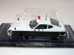 nissan datsun fairlady z model cars nissan fairlady z datsun 240 z japanese police 1 43